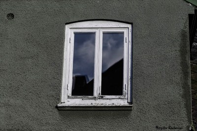 A window with the sky view within