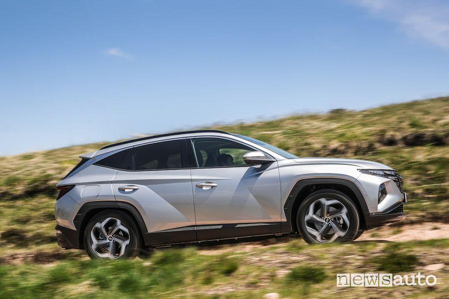 Side view of new Hyundai Tucson Plug-in Hybrid on dirt road