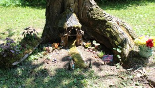 Carefully crafted: Little magic fairy house under a tree.