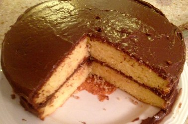 home made yellow cake with real chocolate frosting