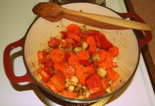 cooking veggies in madras curry paste