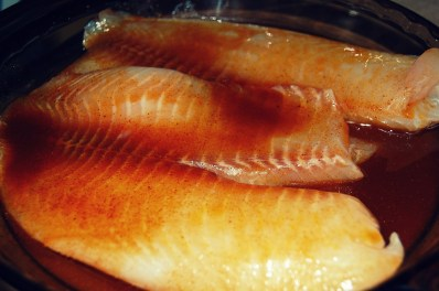 marinade tilapia in spices and olive oil