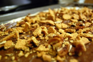 spread graham crackers and pecans on pizza