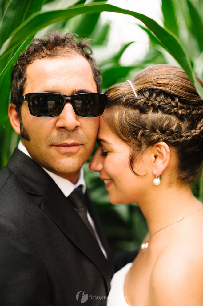Groom in shades in cornfield