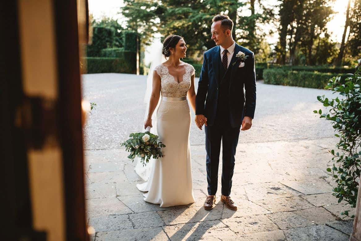 bride and groom entering reception at villa di ulignano wedding