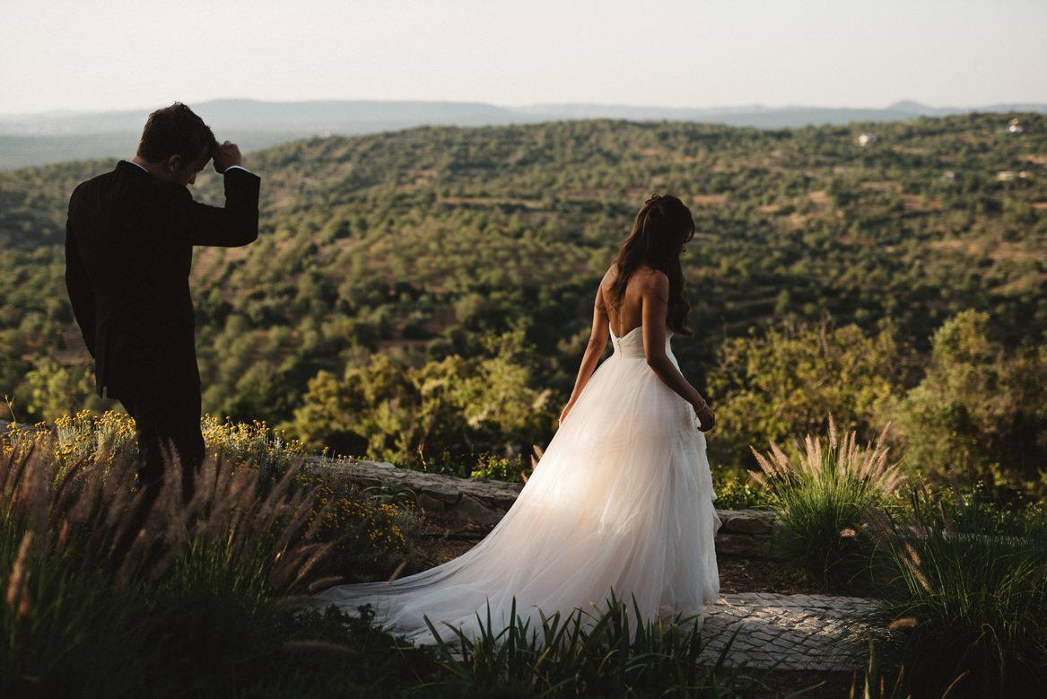 bride and groom walking down a green path during a casa rupi wedding