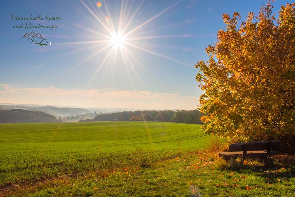 Sonnensterne im Foto von der Eifellandschaft