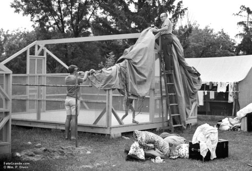 Counselor Keith Christensen on the ground and Phantom Lake YMCA Camp director Sir Gerald Carman on the ladder place the canvas top and sides on a new tent floor and frame. Summer 1968. Photo © William P. Diven. (Click to enlarge)