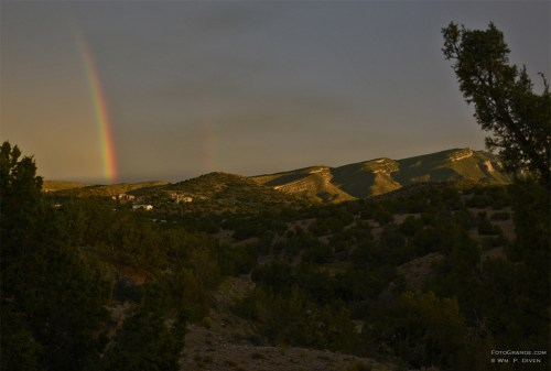 Monsoon rainbow behind the Sandia Mountains near Albuquerque, N.M. Photo © William P. Diven