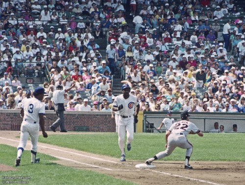 The Cubs Andre Dawson aka The Hawk is out at first base late in the 1991 season. The Cubs beat the Giants this day. No. 3 is first base coach José Martinez, and the first baseman is Will Clark. Photo © William P. Diven.
