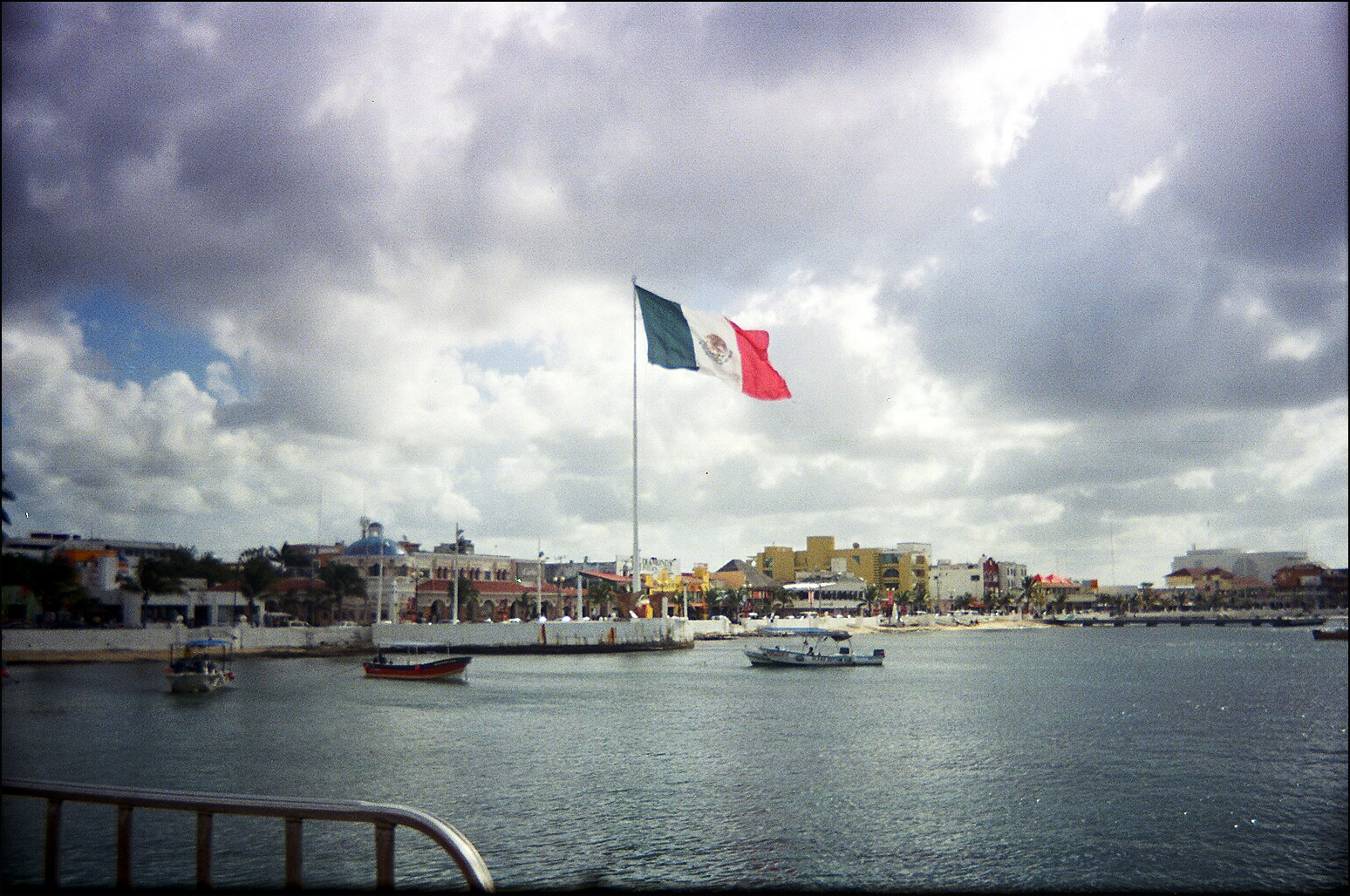 A photo of the Mexican flag near the US border