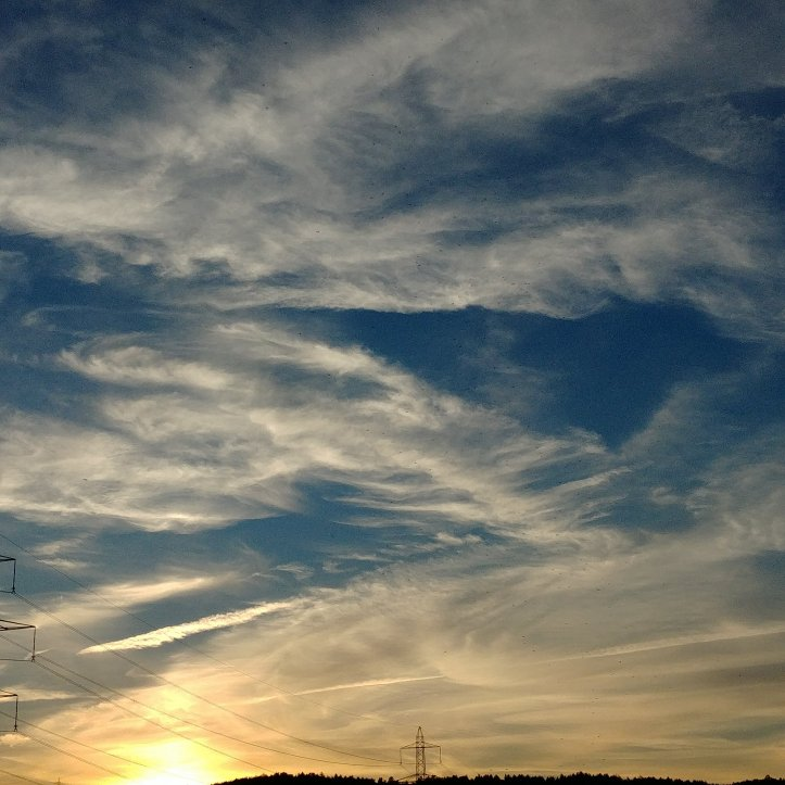 Sunset sky, yellow clouds in blue sky, landscape photo by fotosbykarin
