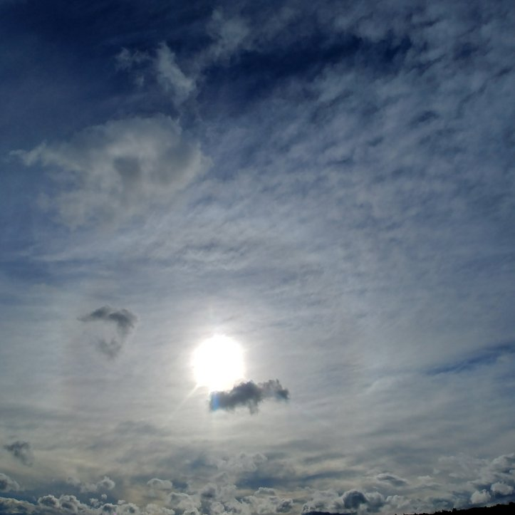 Halo, stormy clouds and sunshine, nature photo by fotosbykarin