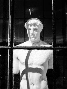 Ancient sculpture as plaster cast watching the city life of Copenhagen