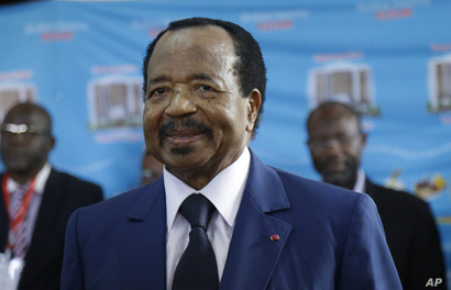 In this Oct. 7, 2018 photo, Cameroon's Incumbent President Paul Biya waits to casts his vote during the presidential elections in Yaounde, Cameroon.