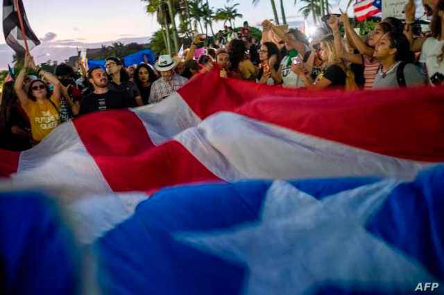 People protest in front of Puerto Rico's Capitol during a demonstration against Puerto Rico Governor Wanda Vazquez and the…