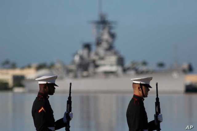 U.S. Marines stand in front of the USS Missouri during a ceremony to mark the 78th anniversary of the Japanese attack on Pearl…
