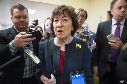 FILE - Sen. Susan Collins, R-Maine, is surrounded by reporters as she heads to vote at the Capitol in Washington, Nov. 6, 2019.