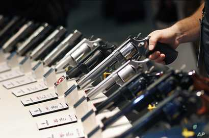 Handguns are displayed at the Smith & Wesson booth at the Shooting, Hunting and Outdoor Trade Show in Las Vegas, Jan. 19, 2016.