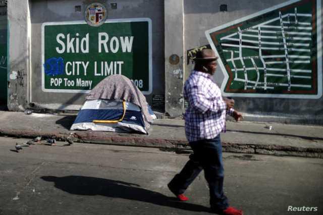 FILE - A man walks on Skid Row in Los Angeles, California, Oct. 14, 2019.