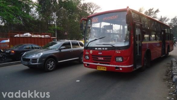 A BMTC Bus and a Porsche Cayenne