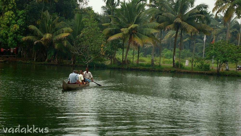 People Rowing on a Backwater in Kuttanad, Kerala
