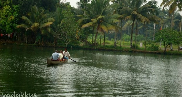 People Rowing on a Backwater in Kuttanad, Kerala