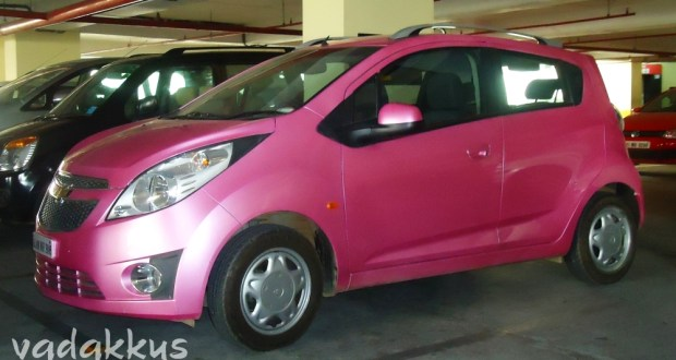 A Bright Pink Chevrolet Beat Car