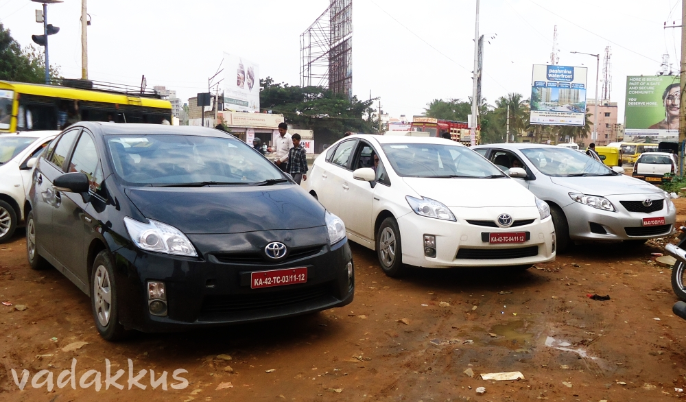 A couple of Toyota Priuses and a Corolla in Bangalore