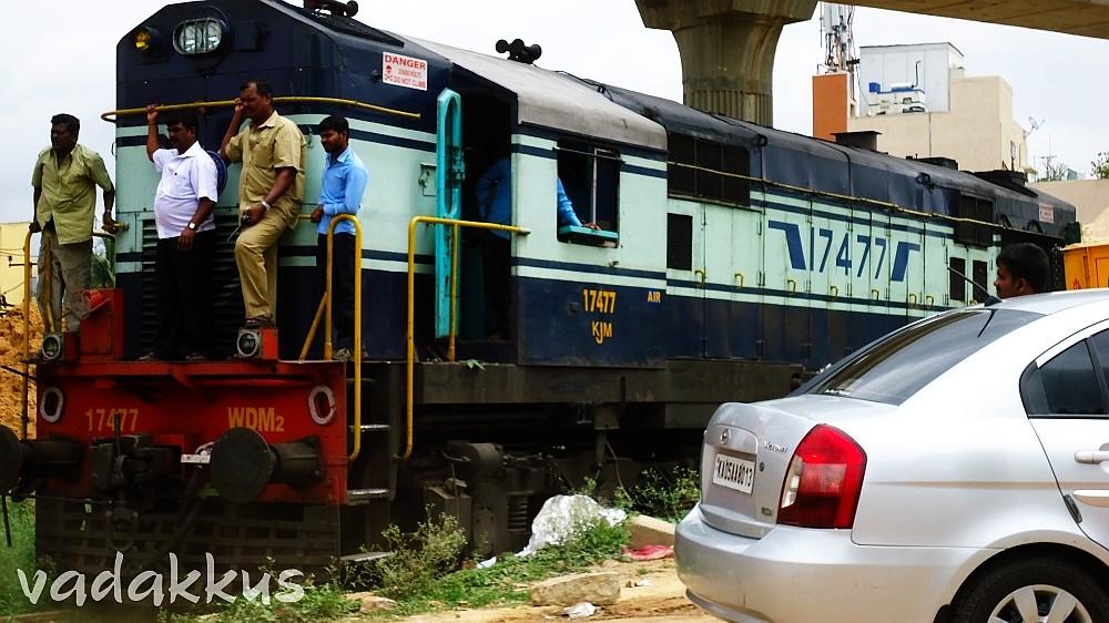 KJM WDM2 #17477 Waits to Cross the Old Madras Road Bangalore