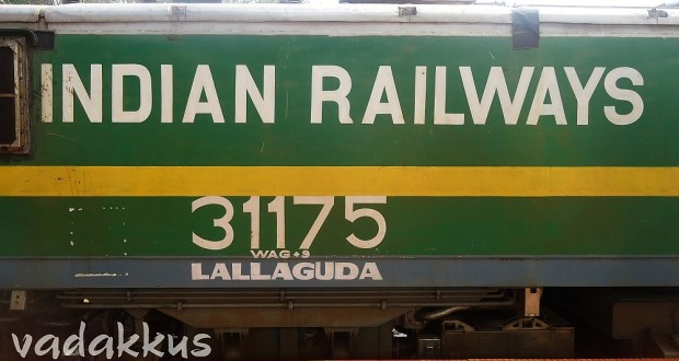 Indian Railways in bold in green and yellow livery of WAG9 locomotive