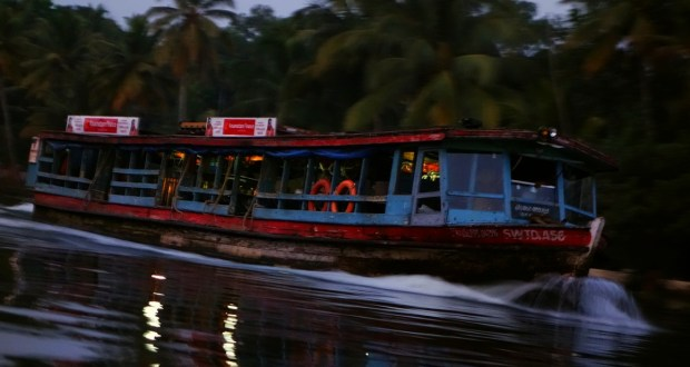Kerala Government Boat cruising along backwaters