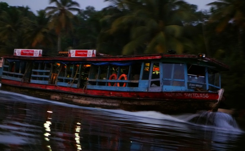 A KSWTC Boat Cruises Along the Backwaters at Dusk