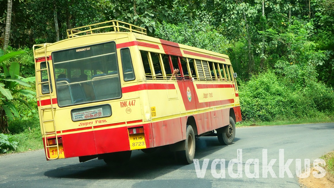 A KSRTC Superfast careens around a bend at high speed on the MC Road in Kerala