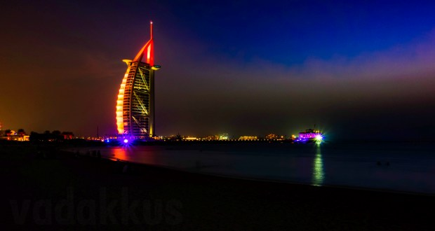 The view of the Burj Al Arab Hotel in Dubai at night.