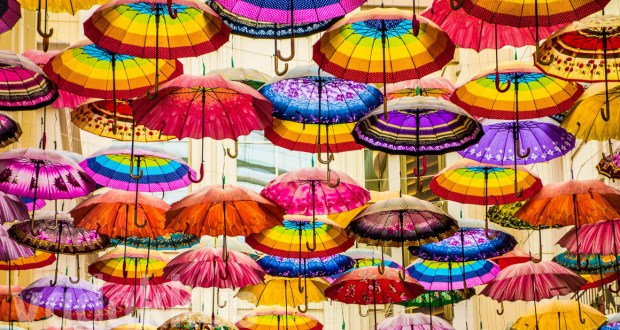 "Colorful Umbrellas hanging, forming the ""ceiling"" at The Village at the Dubai Mall"