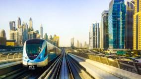 The Dubai Metro against Marsa Dubai, all in Blue and Gold!