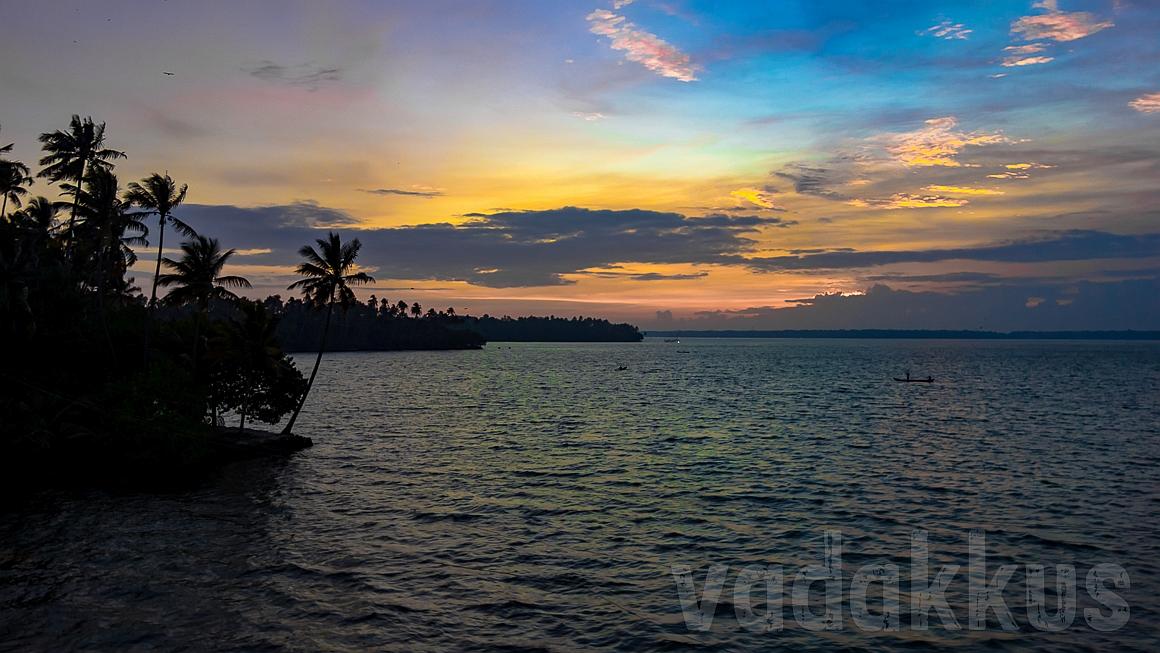 The Ashtamudi Lake near Kollam in Kerala at sunset, a riot of colors