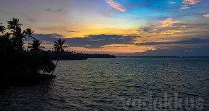 The Ashtamudi Lake near Kollam in Kerala at sunset, a riot of colors
