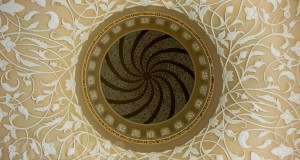 The intricate patterns and designs on the ceiling and inside the dome at the Sheikh Zayed Mosque, Abudhabi