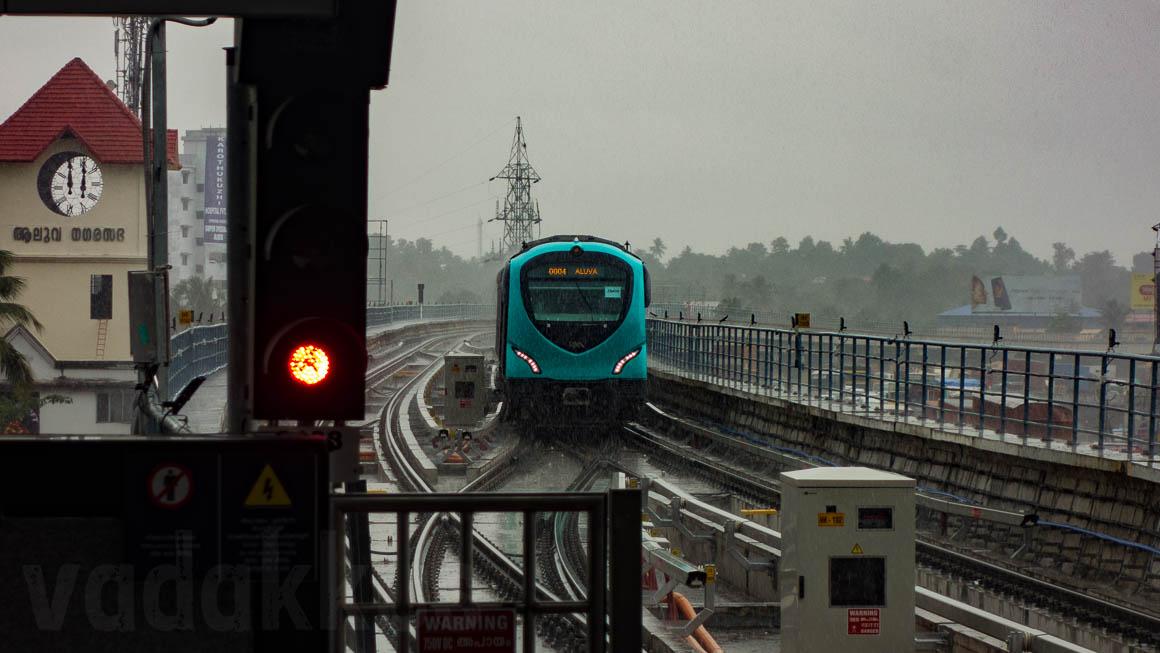 Kochi Metro Train Approaching Aluva Station Through Heavy Rain