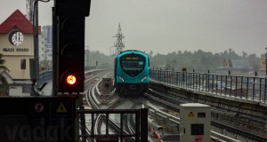 Kochi Metro Train Approaching Aluva Station Through Heavy Rain