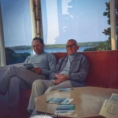 Two men reading a magazine
