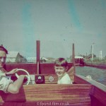 Boy and father on boat in 1963 or 1964