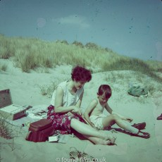 A photo of a boy and his mother on a beach during a holiday