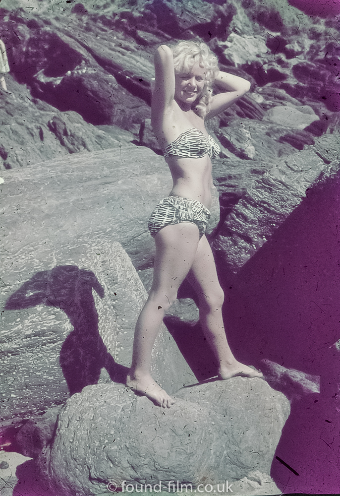 Girl in bikini posing on some rocks