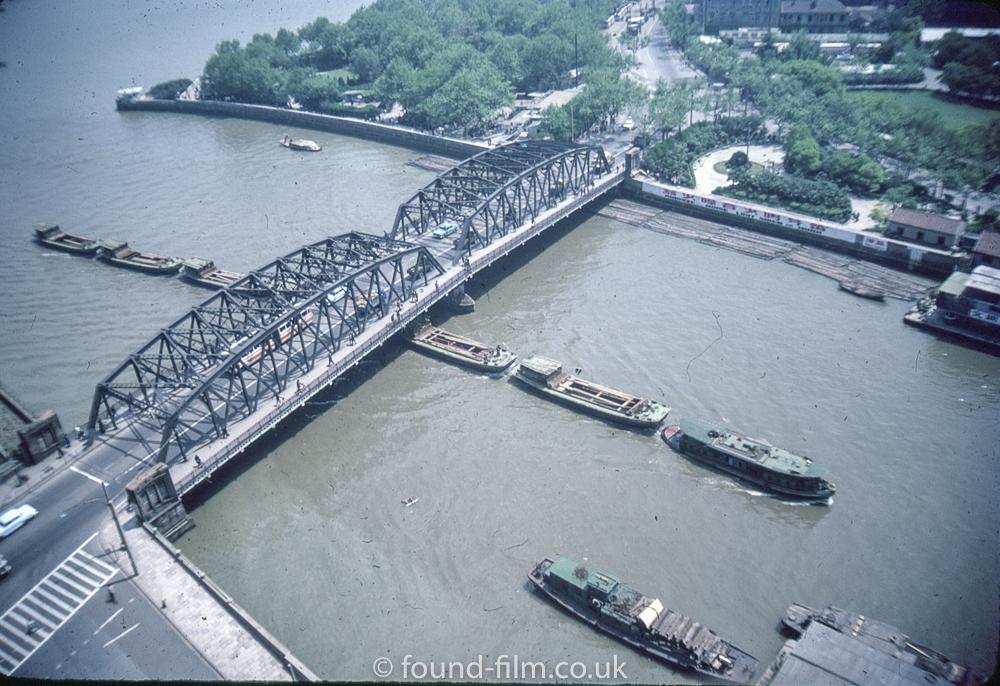 Barges under a bridge