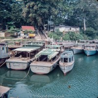 Boats moored on the river in Singapore in the early 1960s