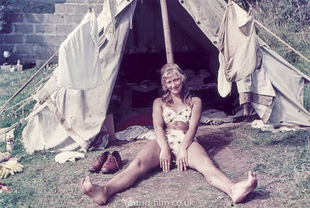 Woman 1 out side tent