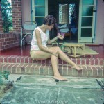 Woman on the steps of a serviceman's quarters at RAF Seletar early 1960s